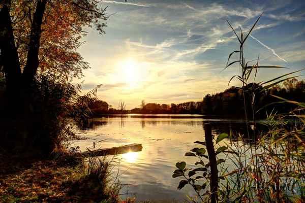 """Spytihněv, vodní plocha """"U jezu"""", západ slunce."""